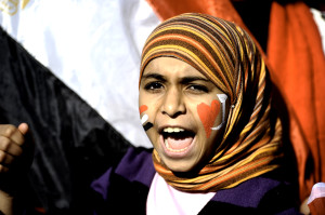 An Egyptian girl shouts slogans against