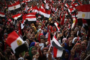 Protesters take part in a protest demanding that Egyptian President Mohamed Mursi resign at Tahrir Square in Cairo