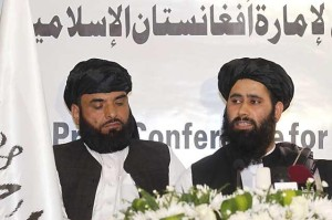 Muhammad Naeem, a spokesman for the Office of the Taliban of Afghanistan speaks during the opening of the Taliban Afghanistan Political Office in Doha
