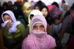 Giovane donna indonesiana emigra in Arabia Saudita, EPA / MAST IRHAM.